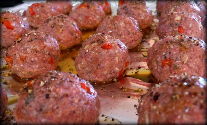 Meatballs lined up for roasting